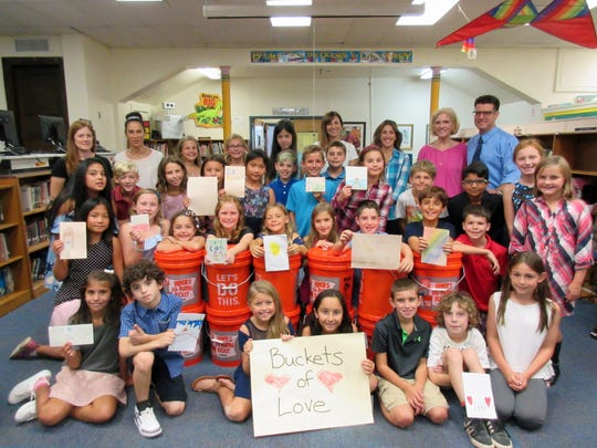 On Sept. 28, McKinley students, teachers and parent volunteers readied 14 Buckets of Love filled with cleaning supplies earmarked for Houston, Texas to aid in the hurricane recovery efforts.