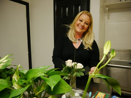 Rebecca Hannant arranges flowers at Bloom and Bean