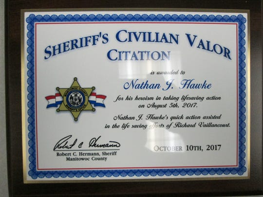 Nathan Hawke, 10, of Two Rivers, was recently honored by the Manitowoc County Sheriff's Office for his efforts in saving his 6-year-old cousin Richard Vaillancourt in August. Pictured is Hawke's Sheriff's Office Valor Citation.