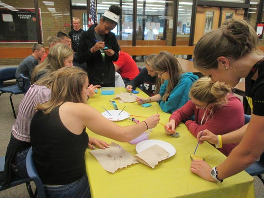 Spencer-Van Etten High School students paint rocks