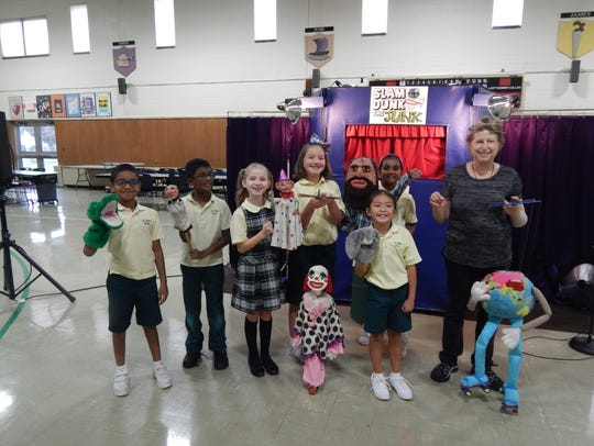 Mariah and her puppets taught students at St. Helena School in Edison about recycling and how to not be a litterbug during a recent program. Several third-graders took part in the show.