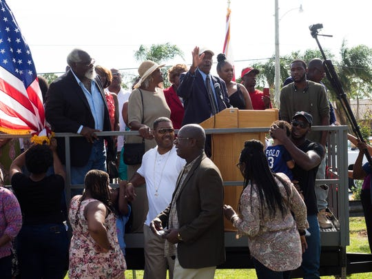 Victor Hart Sr. took the podium at the end of the ceremony, surrounded by his family.