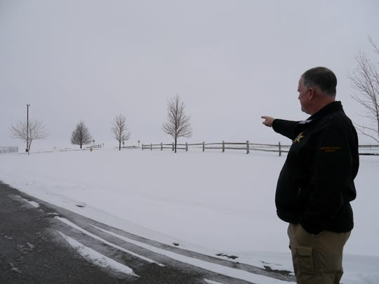 Undersheriff John Stevens points out where the 16-space parking lot expansion will be. Improvements should begin in the spring.