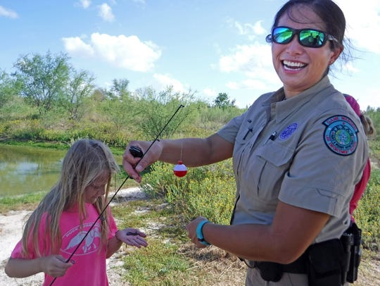 Game Warden Wei-Wei Lin wanted to let the kids see
