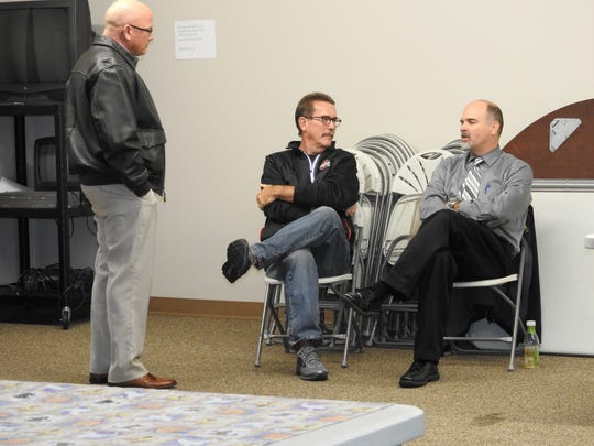 Coshocton County Common Pleas Court Judge Robert Batchelor, Coshocton City Councilman Roger Moore and Coshocton City Schools Superintendent David Hire talk at the Coshocton County Board of Elections as vote totals were revealed Tuesday evening.