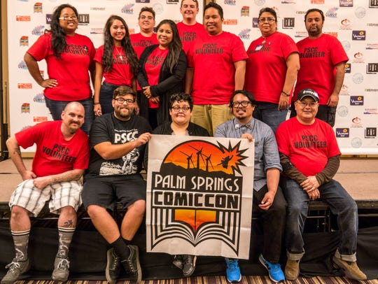 Palm Springs Comic Con volunteers in red shirts during
