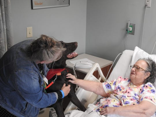 Hospice patient Shirley Stadler gets a visit from Lea Bentley and her canine friend, Buck.