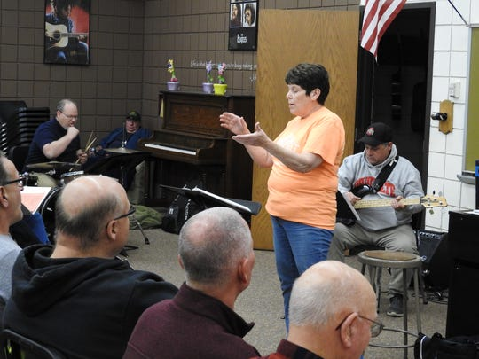 Jean Haumschild conducts a rehearsal for the upcoming Lions Club Minstrel Show. She's been the director of the chorus for 37 years.