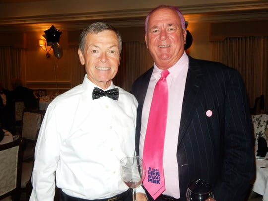 "Mark Ashdown, left, and Indian River County Commissioner Peter O'Bryan, whose hair is dyed pink in honor of the ""Real Men Wear Pink"" campaign supporting American Cancer Society's Making Strides against Breast Cancer."