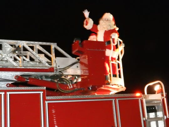 Santa Claus came to town atop a fire truck during the 2017 Miracle on Main Street festivities.