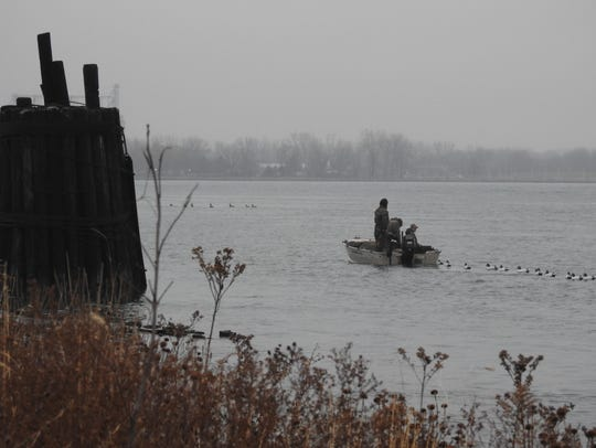 Duck hunters set their decoys in the St. Clair River