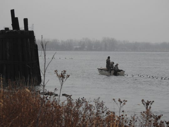 Duck hunters set their decoys in the St. Clair River near the Blue Water River Walk.