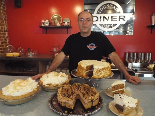 Dennis Wagner and some of the desserts he makes at the Fountain City Diner.