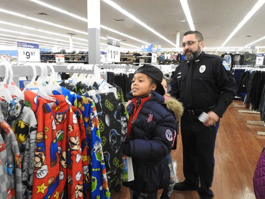 Ten-year-old Nevaeh Perry picks out Star Wars pajamas