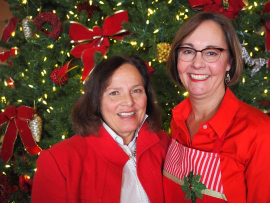Julie Meier and Julia Syburg pause for a festive photo