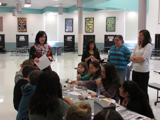 Katie Filosa (far left), Area Supervisor for Maschio's Food Services, discusses cafeteria food choices with Holland Brook School's Student Leaders. Looking on are Student Leader advisors Angel Longo and Linda Riess and parent Heidi Miller.