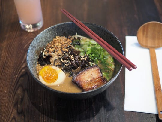 In Orlando, Domu adds to Florida's heat by serving