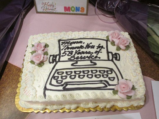 John M. Dorner Adjustment Co. had a cake special made for Mona Zipay complete with a typewriter.
