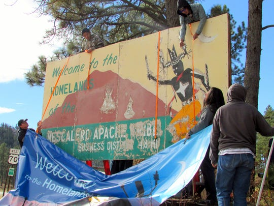 The battered billboard on U.S. 70 is about to be covered with a vibrant new design.