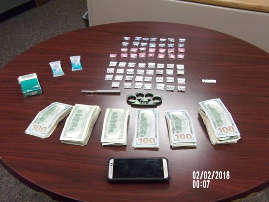 Police display items seized from Joseph Rogers.