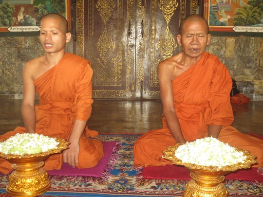 Monks chant a blessing at the Oudong Monastery in Cambodia.