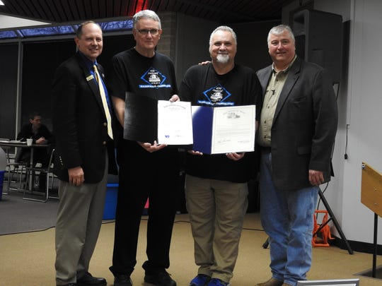 State Sen. Jay Hottinger and State Rep. Larry Householder present Coshocton County Career Center Superintendent Rick Raach and Principal Eddie Dovenbarger with proclamations for the school's 40th anniversary at its recent annual open house.