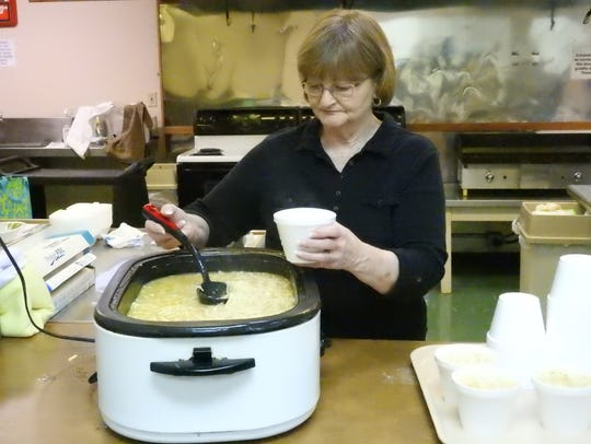 Ann Baker serves chicken noodle soup during a Lenten Luncheon last year in this Tribune file photo.