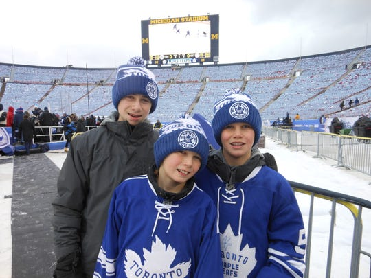 Quinn Hughes (left), Luke Hughes (center) and Jack