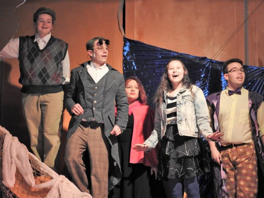 """Kenzie Potter as James, Cole Fisher as Green Grasshopper, Lillian Whitcomb as Ladybug, Halley Jones as Spider and Tyler Huston as Centipede get a glimpse outside their giant peach in """"James and the Giant Peach"""" opening at Coshocton High School."""