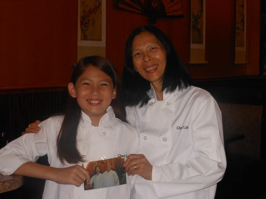 Liai Erion and her daughter Audrey pose for a 2016 photo in the Golden Rooster Chinese Restaurant in Bear. The restaurant is named for the Year of the Rooster, the Chinese zodiac symbol representing the year Audrey was born.