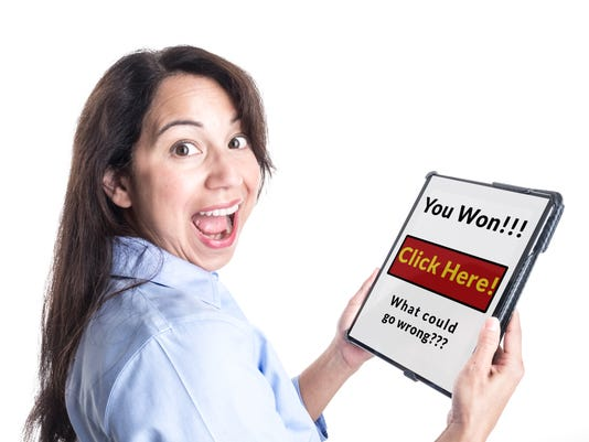 Young Woman Reacts Happily to Winning Prize on her Tablet.