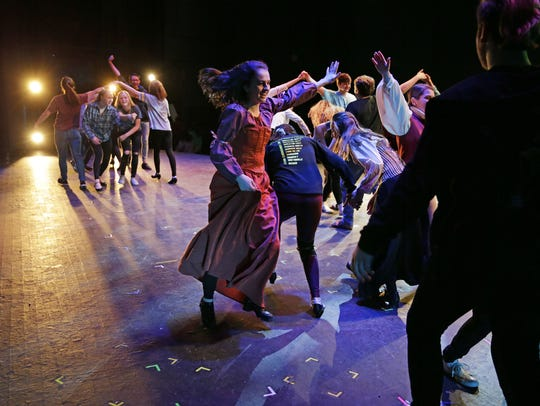 Alexis Killian, center, and other dancers take part
