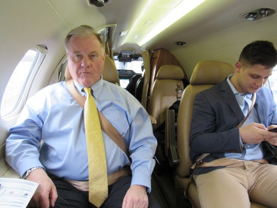 State Sen. Scott Wagner (left), R-Spring Garden Township, sitting on a charter plane set to takeoff in Harrisburg bound for Pittsburgh. (Photo by David Weissman/ The York Dispatch)