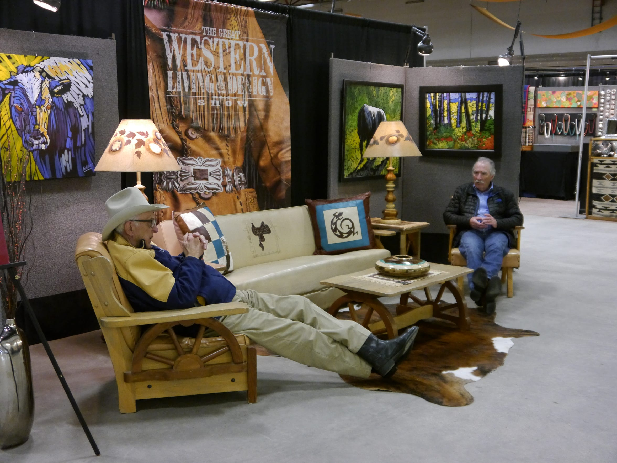 The couches are a popular resting spot during Western Art Week at the Western Living and Design Show in the Four Seasons Arena.