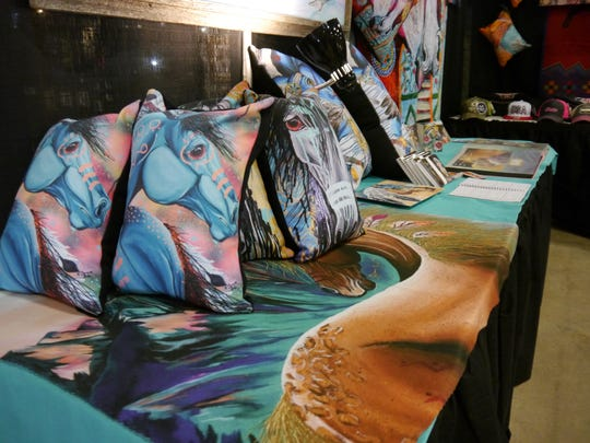 In addition to her original paintings, Sammy Jo Bird has her work screened onto pillows, blankets and clothing. Bird is part of the Native Plains Artists showcase during Western Art Week.
