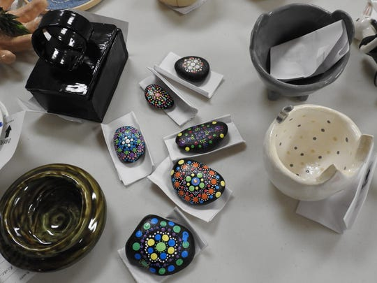 Ceramic works and painted rocks that will be on display