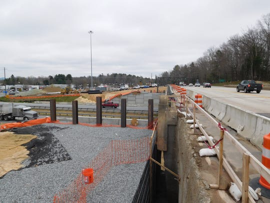 Workers are widening the Brevard Road bridge over Interstate 26 as part of a project to make several changes at the interchange.
