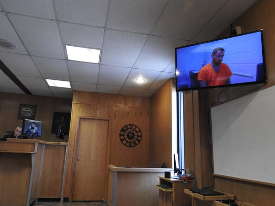 Ryan Adams, 30, of Zanesville, shown during a court appearance via a video screen from the Zanesville City Jail, is charged with aggravated murder in the death of Kylee Lindell.