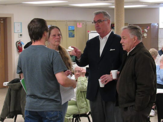 (left to right) Pleasant Acres employee Jason Rodes and Deb Davis, director of Northeastern Senior Community Center, speak with York County Commissioners Chris Reilly and Doug Hoke ahead of a meeting with supporters of Save Pleasant Acres on Friday, April 20, 2018. (David Weissman photo)