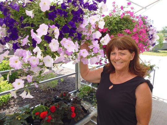 Faye Daughters Conrad sells flowers for Kinman Farms