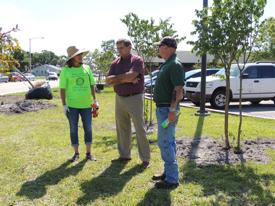 Rotarian Robin Pelensky with the Indian River County School District's Robert Michael and Otherside Services Mike Bertin at the Freshman Learning Center where 69 trees were planted.