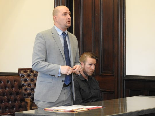 Attorney Kevin Cox speaks on behalf of his client, Michael McVay II, during a hearing Thursday in Coshocton County Common Pleas Court. McVay received 72 total months in prison for two counts of unlawful sexual conduct with a minor.