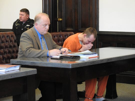 Public Defender Jeffrey Mullen sits next to Richard Huston as he cries in court listening to the mother of his victim speak Thursday in Coshocton County Common Pleas Court. Huston received 36 months in prison for two counts of sexual conduct with a 14-year-old boy.