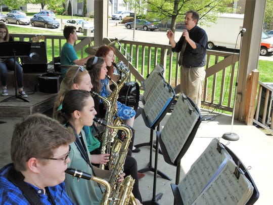 Barry Hardesty leads the Coshocton High School Jazz Band Tuesday on the Coshocton Court Square during a performance for the Dogwood Youth Arts Celebration.
