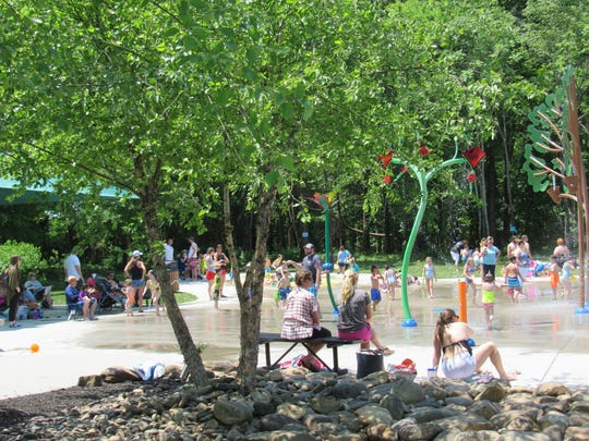With temperatures reaching record levels last week, a crowd sought cool relief in the splash pad at McFee Park.