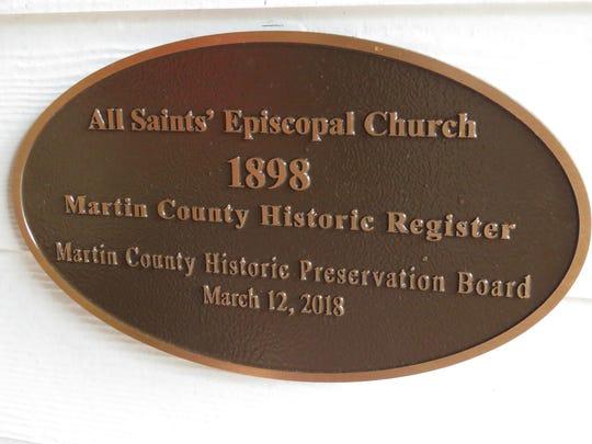 The plaque designating All Saints' Episcopal Church as a Martin County Historic Site.
