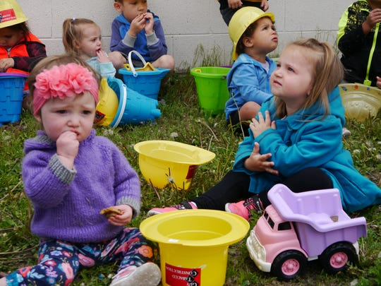 Children from Play 'n' Learn Preschool and Daycare help with the groundbreaking on a new 10,000 square-foot childcare center on Great Falls' east end.