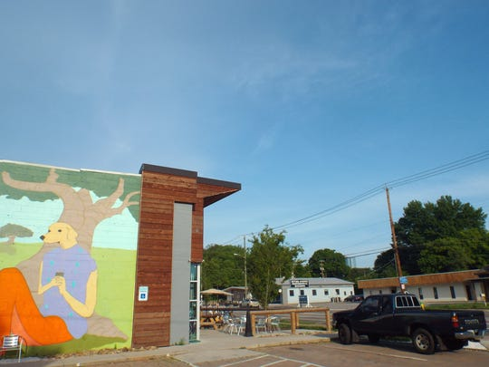 A mural painted by Perry Hodson serves to beautify the Sevier Avenue neighborhood.