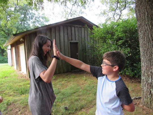 Counselor Caitlin Waters got a high-five from a camper.