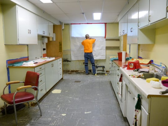 Erik Seilstad of HazTech works in the lower level of the Great Falls YWCA. When renovations are complete, the YWCA will have a usable kitchen space as part of a 5,000-square-foot remodel of the building.